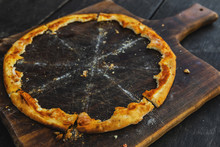 Crunchy Crusts Of Delicious Pizza On The Wooden Board