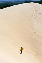 Boy Walking On The San Dunes
