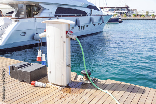 Shore Based Electricity Supply Appliance Power Supply And Battery Charged on the dock .