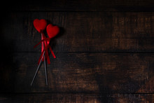 Two Red Hearts On Dark Wooden Background For Valentines Day