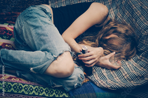 Valokuva Young drunk woman on the sofa