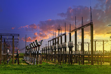 High Voltage Electric Power Station - Electric Poles And Lines On Blue Sunset Cloudy Sky Background