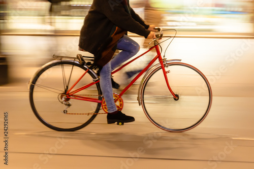 bicycle rider in the city at night