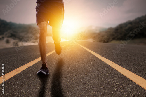 Fotografía  Goal and Strive concept, Runner run on road with sun rising.