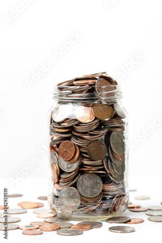 Fényképezés  Money in jar on a white background