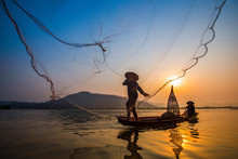Fisherman On Boat River Sunset Asia Fisherman Net Using On Wooden Boat Casting Net Sunset Or Sunrise In The Mekong River