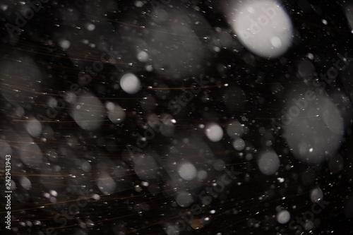 Fototapeta Background of falling snowflakes in the light of a lantern. obraz na płótnie