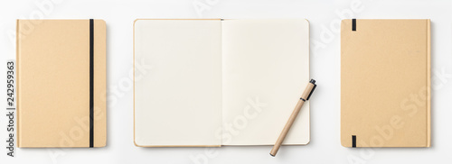 Photo Top view of kraft paper notebook, page, pencil