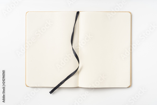 Top view of kraft paper notebook, page, bookmark Canvas Print