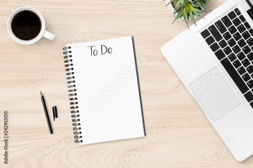 Photo  Notebook with to do text on it over wood office desk table with supplies