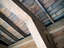 Wooden Support Beam And Roof Lathing Riveted To It