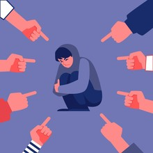 Vector Concept Of Bullying And Teen Harassment. Lonely Young Man Victim Sitting Holding Knees With Sad Depressed Face With Hands Pointing To Him.