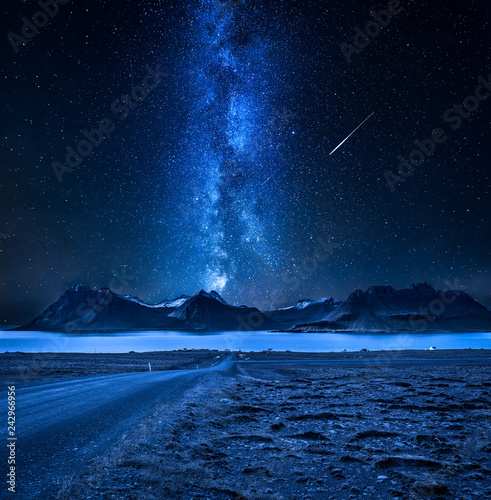 Spoed Foto op Canvas Heelal Mountain peaks, fjords and milky way in Iceland at night