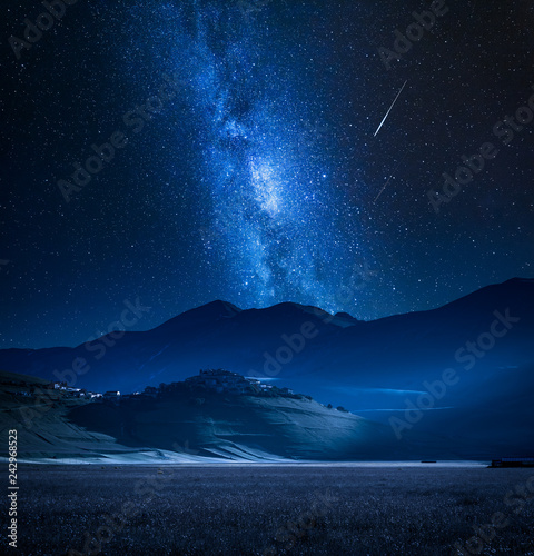 Foto auf Leinwand Gebirge Wonderful milky way over Castelluccio at night, Umbria, Italy, Europe