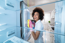 Woman Cleaning Refrigerator Wi...