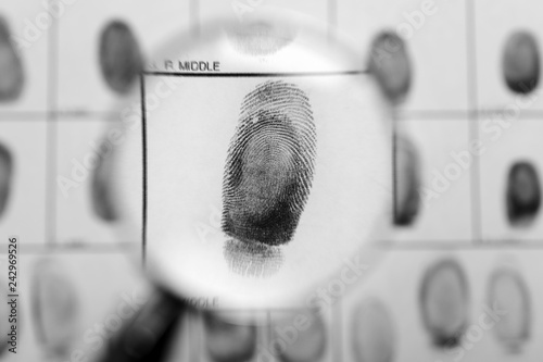 Criminal fingerprint card and magnifier, top view