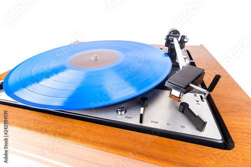 Fotografie, Obraz  Vintage turntable with a blue vinyl isolated on white