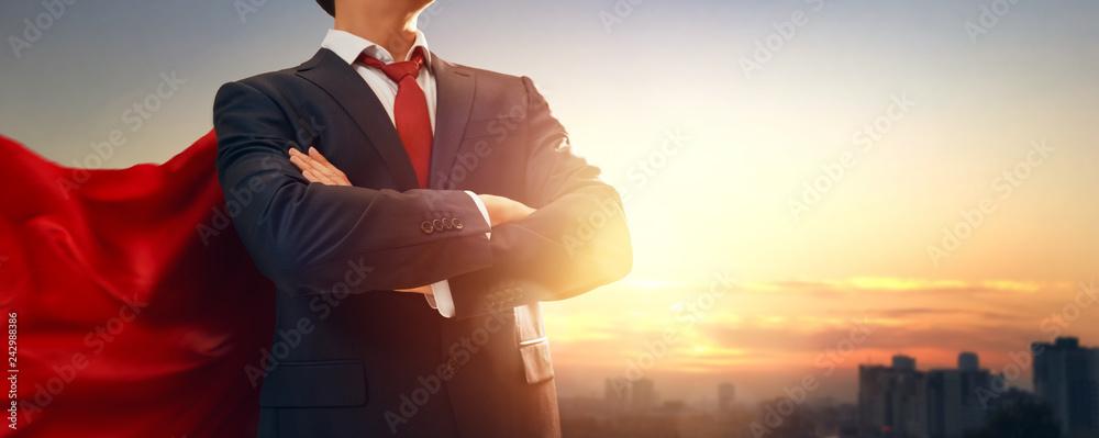 Fototapeta superhero businessman looking at city