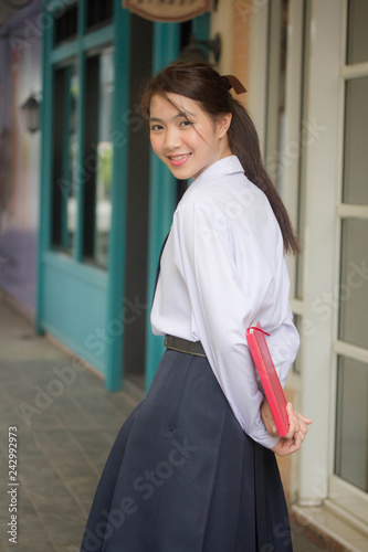 Fotografía  Portrait of thai high school student uniform teen beautiful girl happy and relax