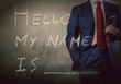 Self Introduction - Hello, My name is ... written on a blackboard with businessman
