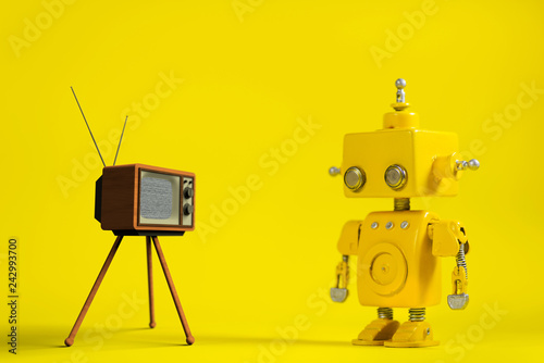 Cute yellow handmade robot on a yellow background with a retro television Wallpaper Mural