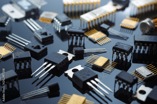 Electronic components close-up. Golden electronic microcircuits.