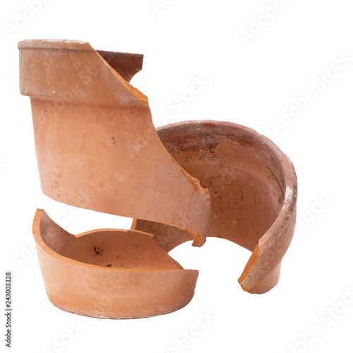 A broken terracotta flowerpot isolated on white, frost damage.