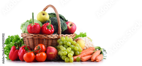 Fresh organic fruits and vegetables in wicker basket Canvas Print