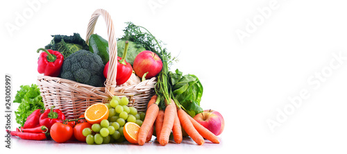 Tuinposter Groenten Fresh organic fruits and vegetables in wicker basket