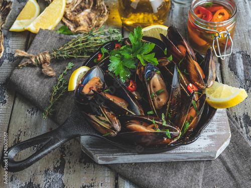 Recess Fitting Seafoods Cooked seafood steamed clams mussels in the iron pan portion with lemon and seasoning