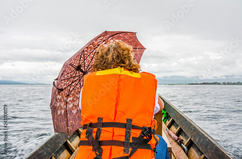 Keuken foto achterwand Asia land female tourist in water taxi at Inle lake