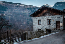 A Traditional Alpine Cottage, Overlooking A Valley In The French Alps, In Winter