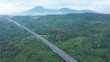 Beautiful aerial landscape of Trans-Java Toll Road with tropical forest background at Semarang, Central Java, Indonesia. Shot in 4k resolution