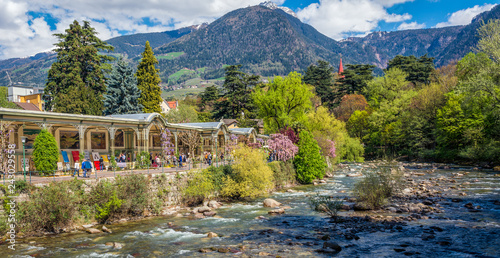 Fotografie, Obraz Meran in South Tyrol, a beautiful city of Trentino Alto Adige, View on the famous promenade along the Passirio river