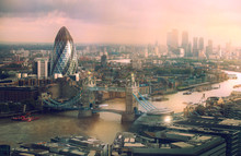 London View At Sunset. Panorama Include River Thames, Tower Bridge And City Of London And Canary Wharf  Buildings.