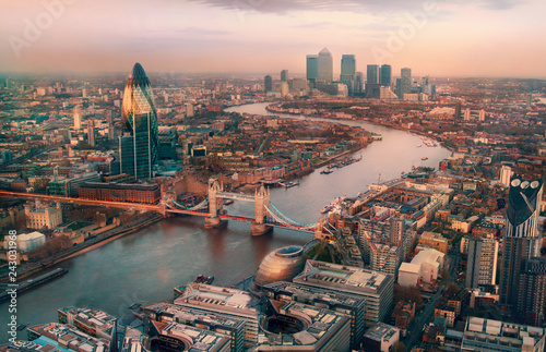 Poster London London view at sunset. Panorama include river Thames, Tower bridge and City of London and Canary Wharf buildings.
