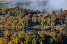 The Cloud Over Derwent Water Lake In The Lake District Cumbria With Autumn Colours And View Of Pier In The Clear Water.