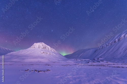 Cadres-photo bureau Aurore polaire The polar arctic Northern lights aurora borealis sky star in Norway Svalbard in Longyearbyen the moon mountains