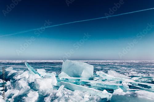 Fotografie, Obraz  Melting ice cracks. Arctic winter background.