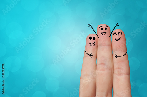 Valokuva Joyful fingers smiling with colorful background concept