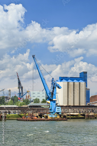 Crane vessel moored in Port of Rotterdam on a sunny day. © tonyv3112