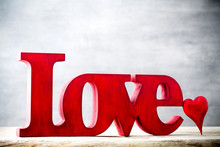 Love. Message Of Love With Red Wooden Letters.