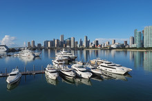 Miami, Florida 09-15-2018 The Island Gardens Deep Harbour Super-yacht Marina With The City Of Miami Reflected On Calm Biscayne Bay In The Background.