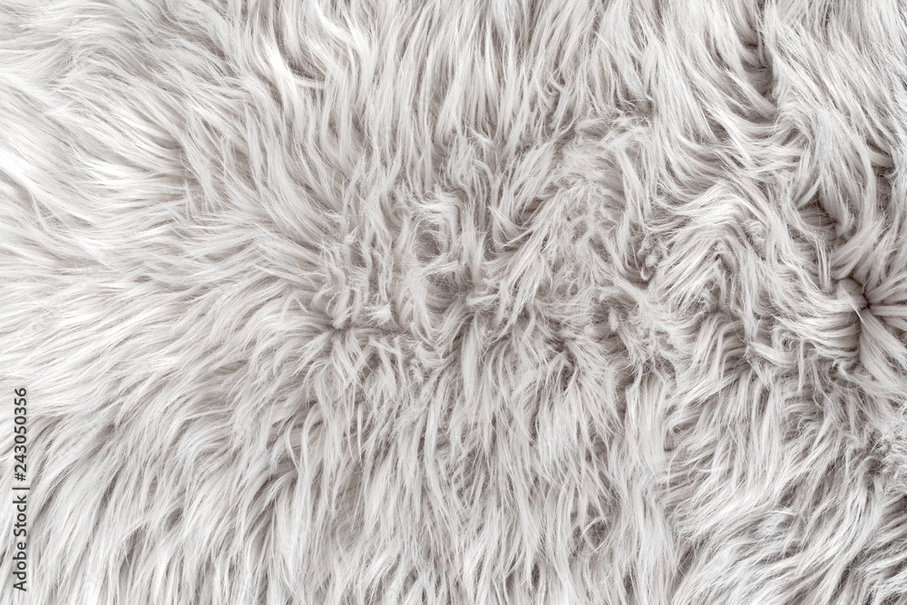 Fototapeta White fur for background or texture. Fuzzy white fur plaid. Shaggy blanket background. Fluffy fake textile fur. Flat lay, top view, copy space