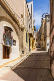 Fototapeta Na drzwi - Colorful uphill street in Sciacca historic centre, Sicily, Italy