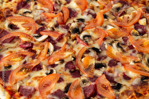 Fotografie, Obraz  Bavarian pizza with sausages and mushrooms, juicy tomatoes and Parmesan