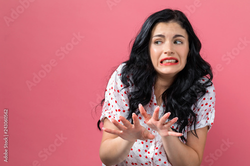 Photo Disgusted face expression with young woman on a solid background