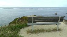 A Bench Overlooks The Pacific Coast In Monterey