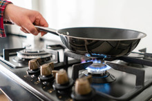 A Man Cooks In A Frying Pan, P...