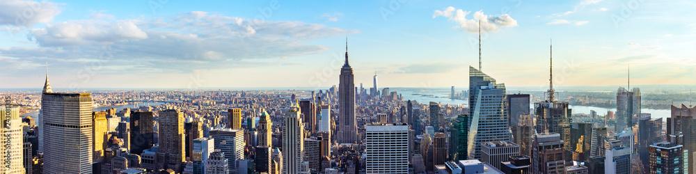 Fototapeta New York City skyline from roof top with urban skyscrapers before sunset.New York, USA. Panorama image.
